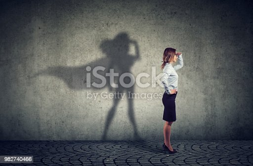 istock Brave woman posing as super hero 982740466