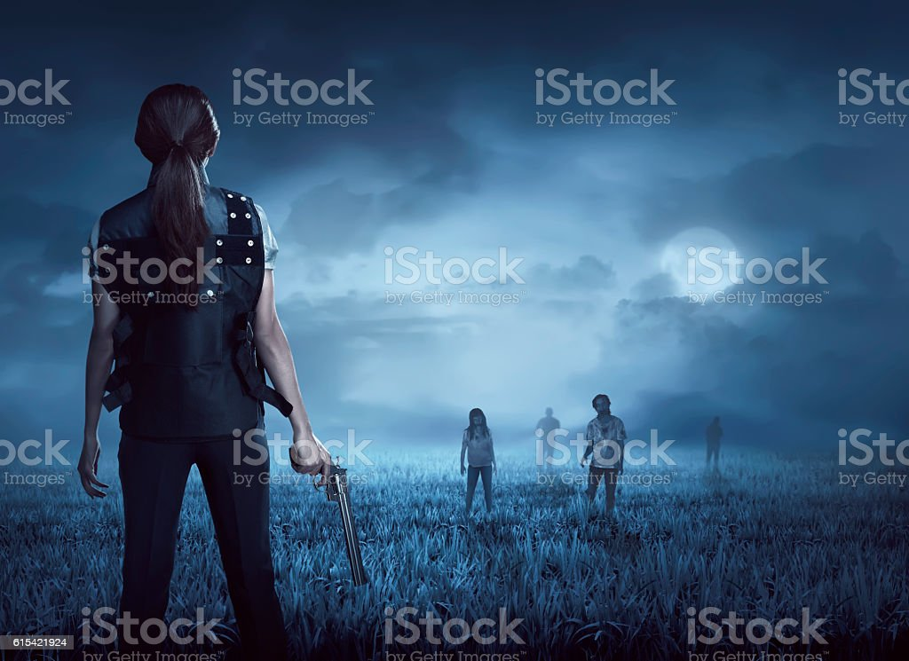 Brave woman with vest find the zombies stock photo