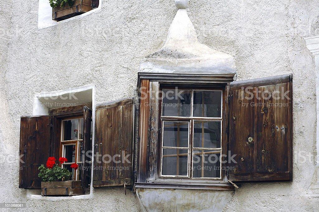 Bravuogn (Bergun, Engadine, Graubunden, Switzerland): two windows of old house stock photo