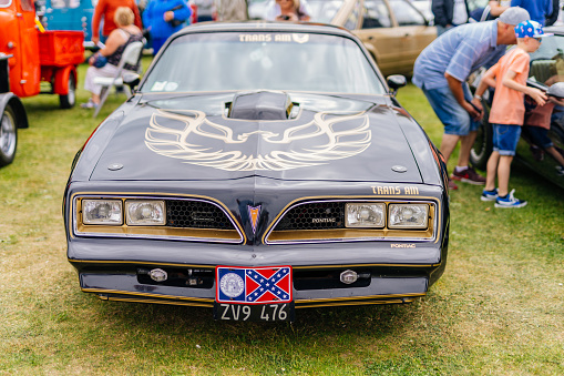 Bray, Ireland, June 2018 Bray Vintage Car Club show with open air retro cars display. Front view on black Pontiac Firebird from 1979