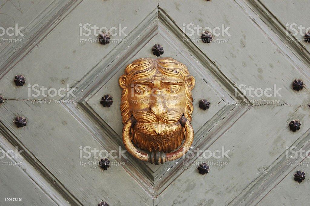 Brazen lion head door knocker royalty-free stock photo