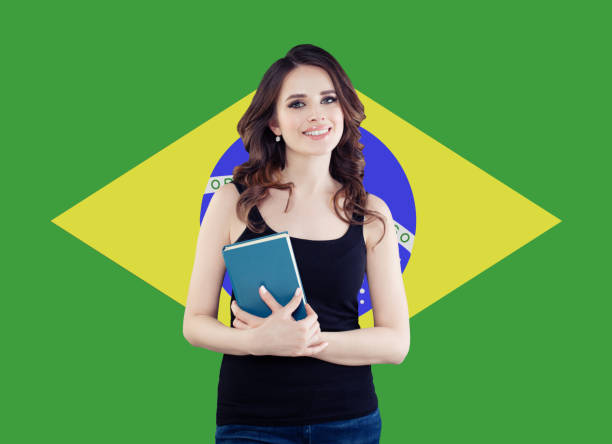 Brazil concept with cute woman student against the Brazilian flag background. Travel in Brazil and learn portuguese language stock photo