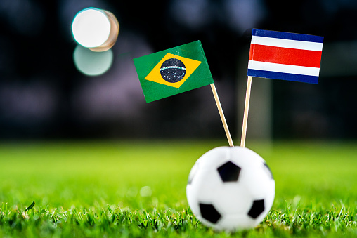 Brazil - Costa Rica, Group E, Friday, 22. June, Football, World Cup, Russia 2018, National Flags on green grass, white football ball on ground.
