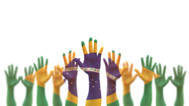Brazil flag on people palm hands raising up for volunteer, voting, help wanted, and national holiday celebration praying for Brazilian power isolated on white background (clipping path) stock photo