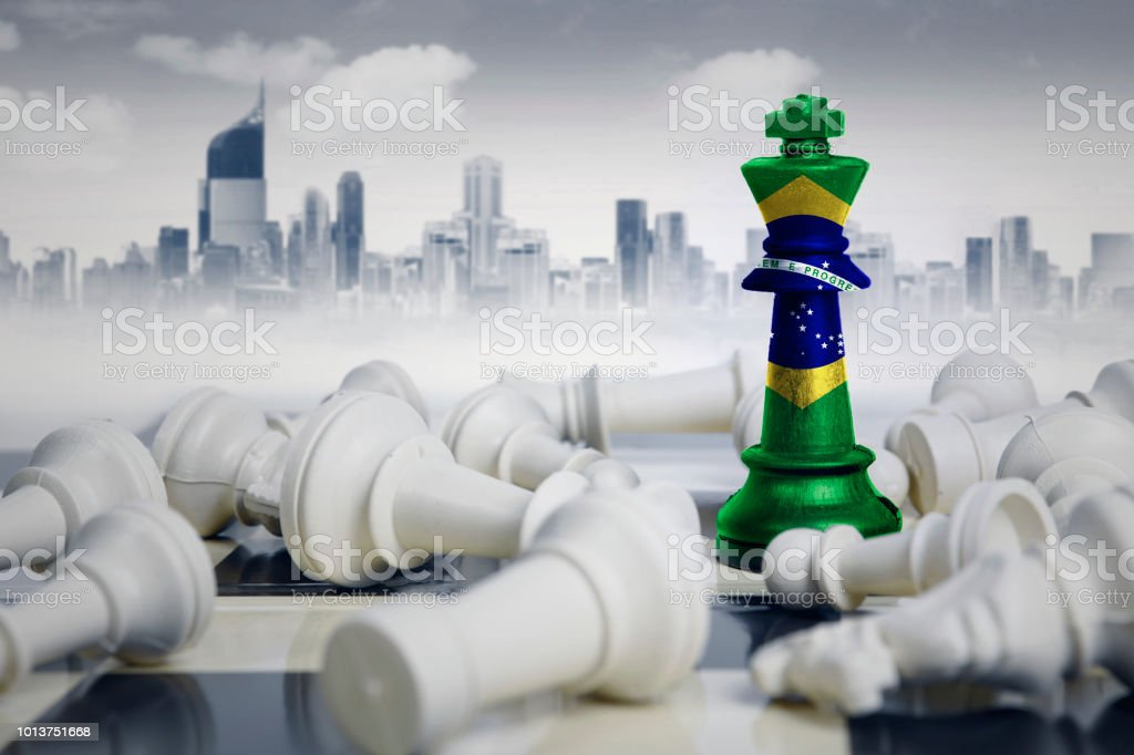 Brazil flag with white chess pieces stock photo