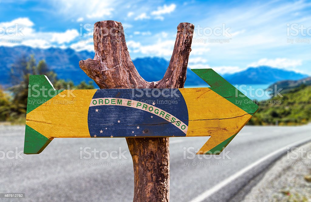 Brazil Flag wooden sign with a road background stock photo