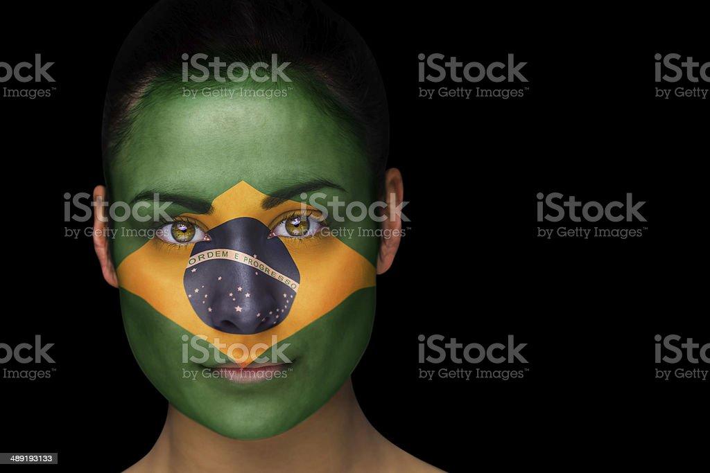 Brazil football fan in face paint stock photo
