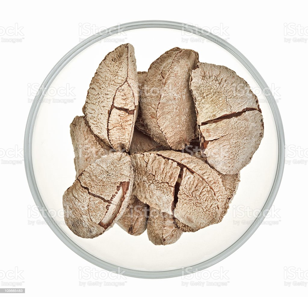 Brazil nuts in a glass bowl isolated on white royalty-free stock photo