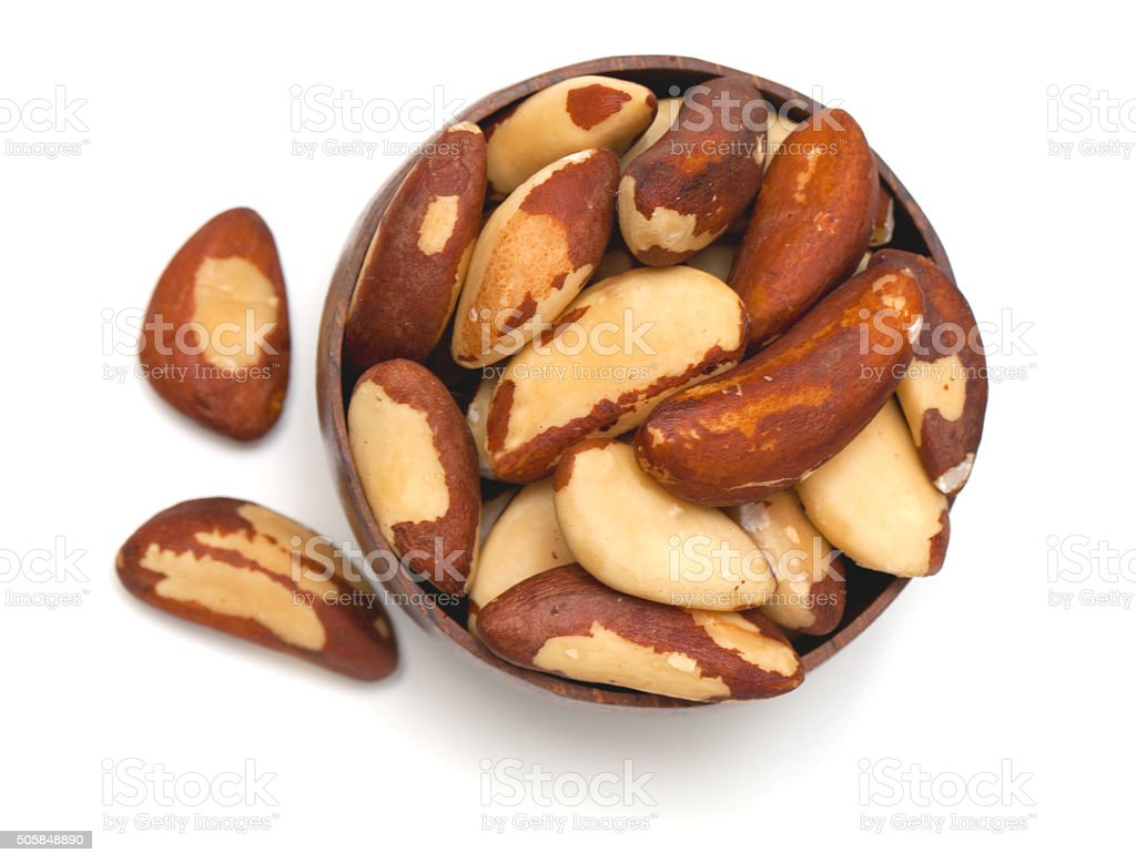 brazil nuts in a wooden bowl stock photo
