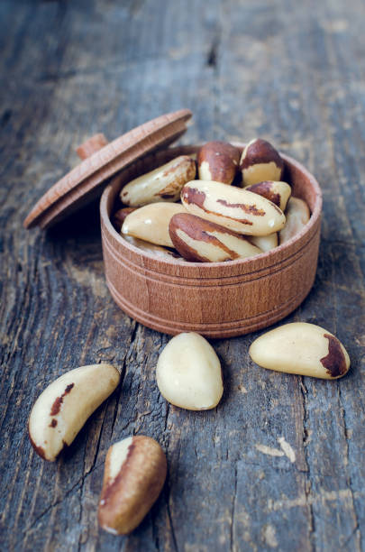 Brazil nuts on the old wooden background stock photo