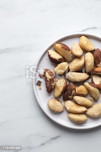 Brazil nuts on white marble background