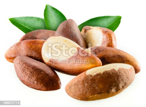 Brazil nuts with leafs isolated on white background