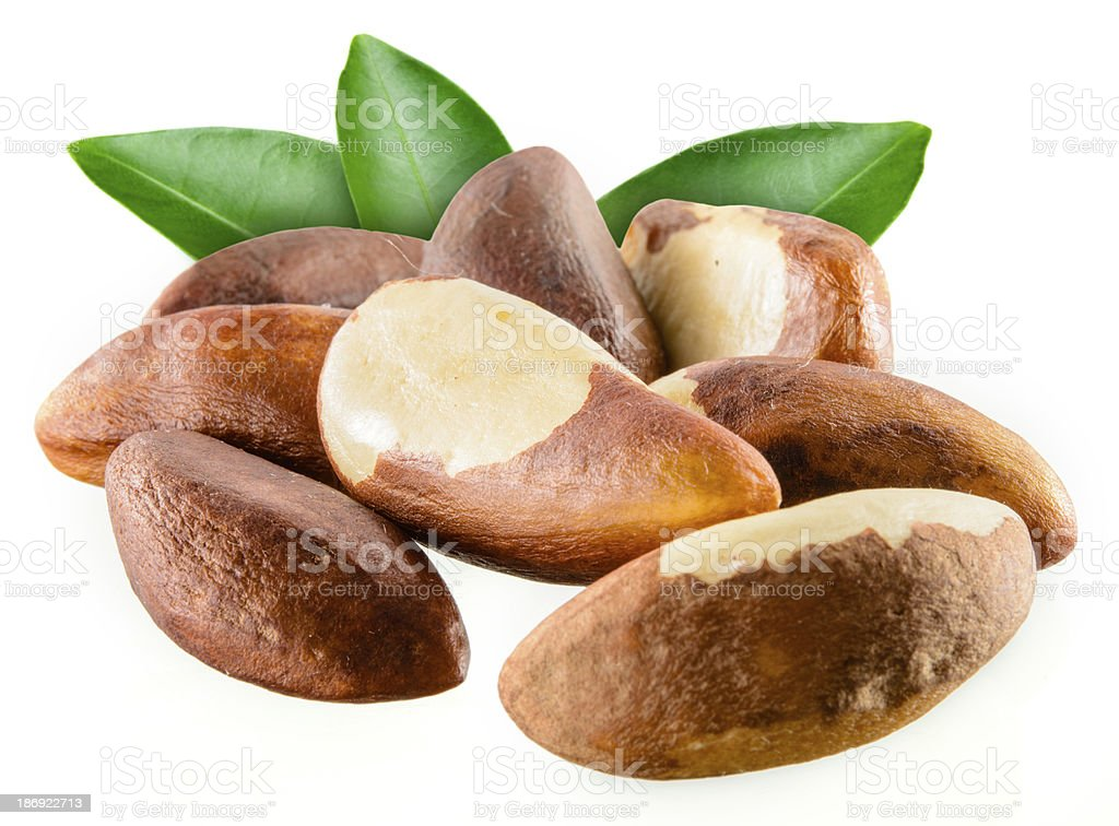 Brazil nuts with leafs isolated on white background stock photo