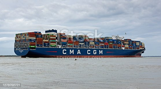 Charleston, SC/USA - September 20, 2020: Brazil, a new Panamax class container ship owned by French transportation firm CMA CGM, enter Charleston Harbor on its way to the Wando Welch Terminal.