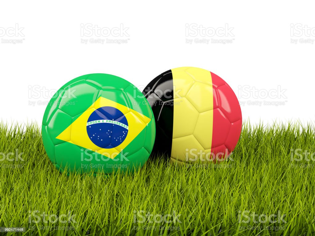 Brazil vs Belgium. Soccer concept. Footballs with flags on green grass stock photo
