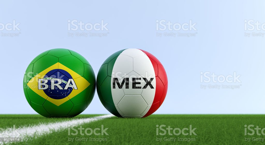 Brazil vs. Mexico Soccer Match - Soccer balls in Brazils and Mexicos national colors on a soccer field. Copy space on the right side - 3D Rendering стоковое фото