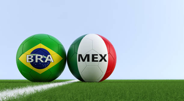 Cтоковое фото Brazil vs. Mexico Soccer Match - Soccer balls in Brazils and Mexicos national colors on a soccer field. Copy space on the right side - 3D Rendering