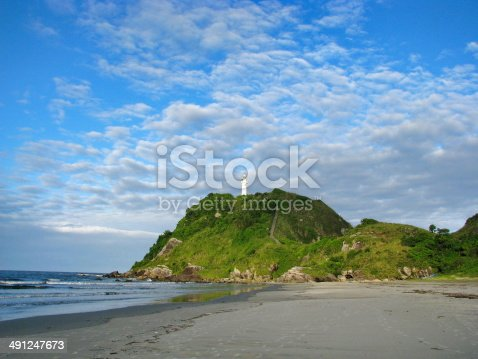 Wild beach and lighthouse at Ilha do Mel (Honey Island) near Curitiba, Brasil.