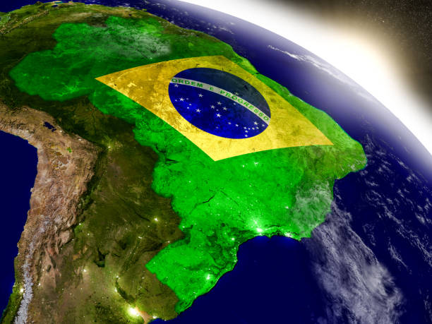 Brazil with flag in rising sun stock photo