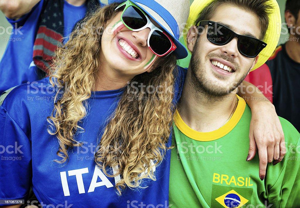 Brazilian and Italian Fans Embraced stock photo