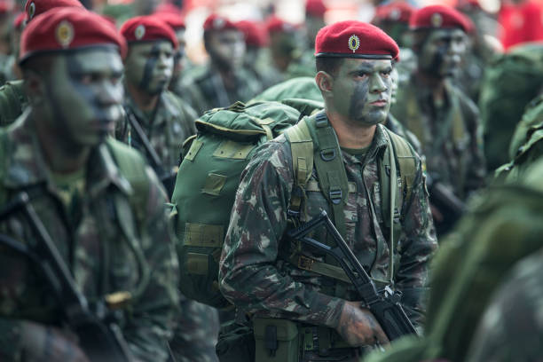 Brazilian army soldier in camouflage Rio de Janeiro, Brazil. 07th September 2016. Army troopers marching together parading in full military uniform and camouflage during Brazilian Independence day parade, Downtown Rio de Janeiro. trooper stock pictures, royalty-free photos & images