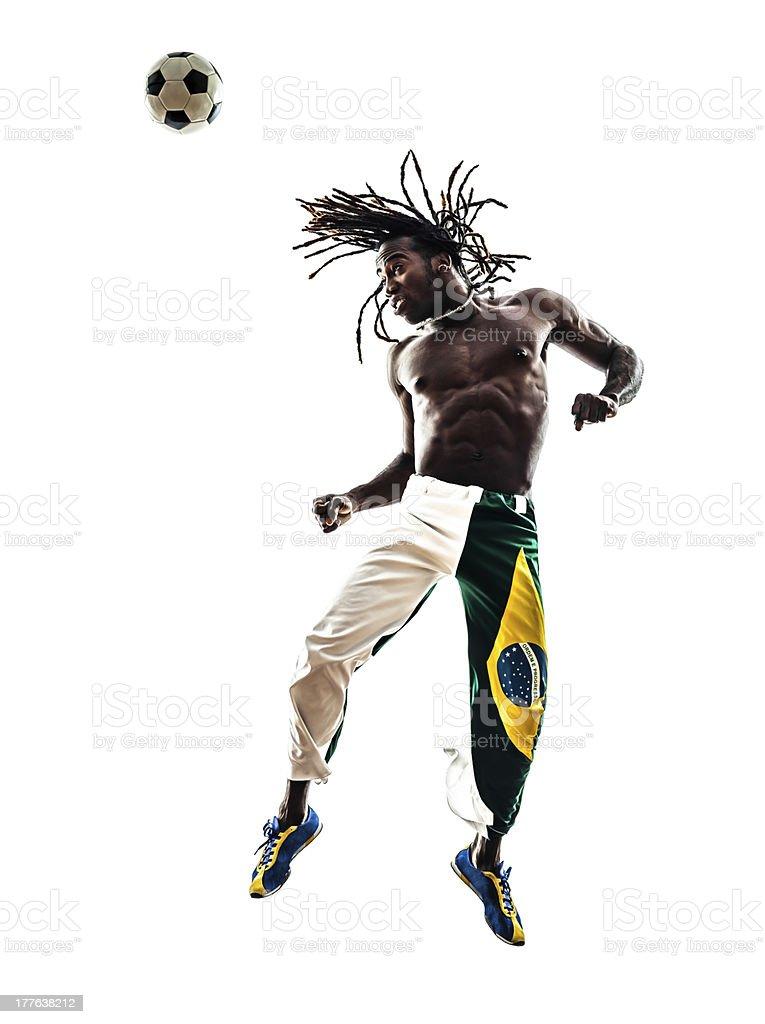 brazilian black man soccer player heading football silhouette royalty-free stock photo