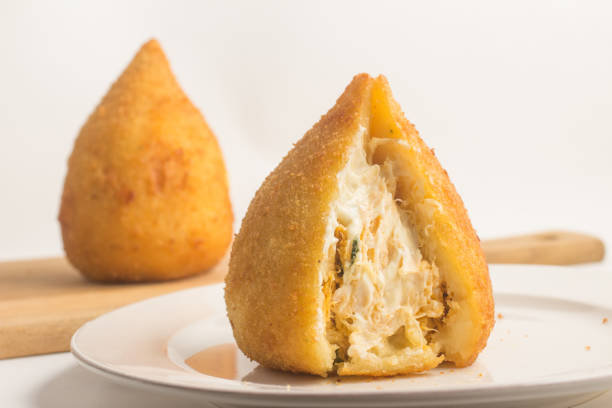brazilian chicken coxinha - coxinha stock photos and pictures