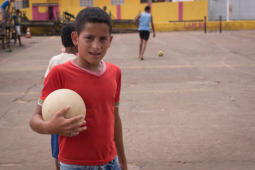 Vicencia, Brazil - October 28, 2014: Brazilian child from the impoverish northeaster region posing with a soccer ball.