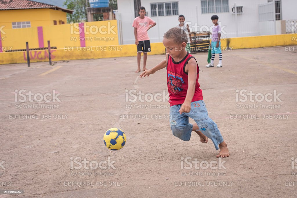 Brazilian child with ball stock photo