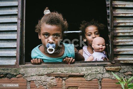 Brazilian children at the window