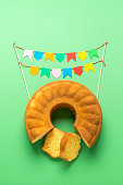 istock Brazilian cornmeal cake and party flags. Festa Junina festival 1227233566