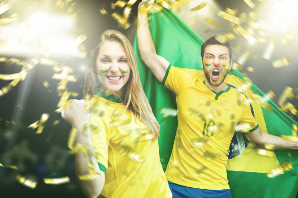 Brazilian couple fan celebrating stock photo