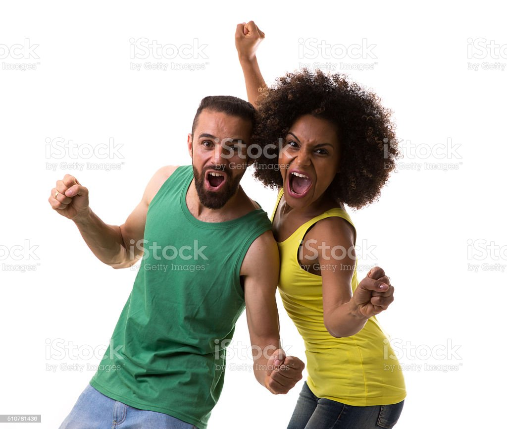Brazilian couple of fans celebrating on white background stock photo