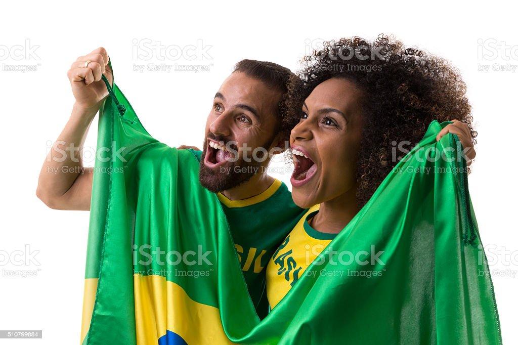 Brasileira casal de fãs celebrar em fundo branco - foto de acervo