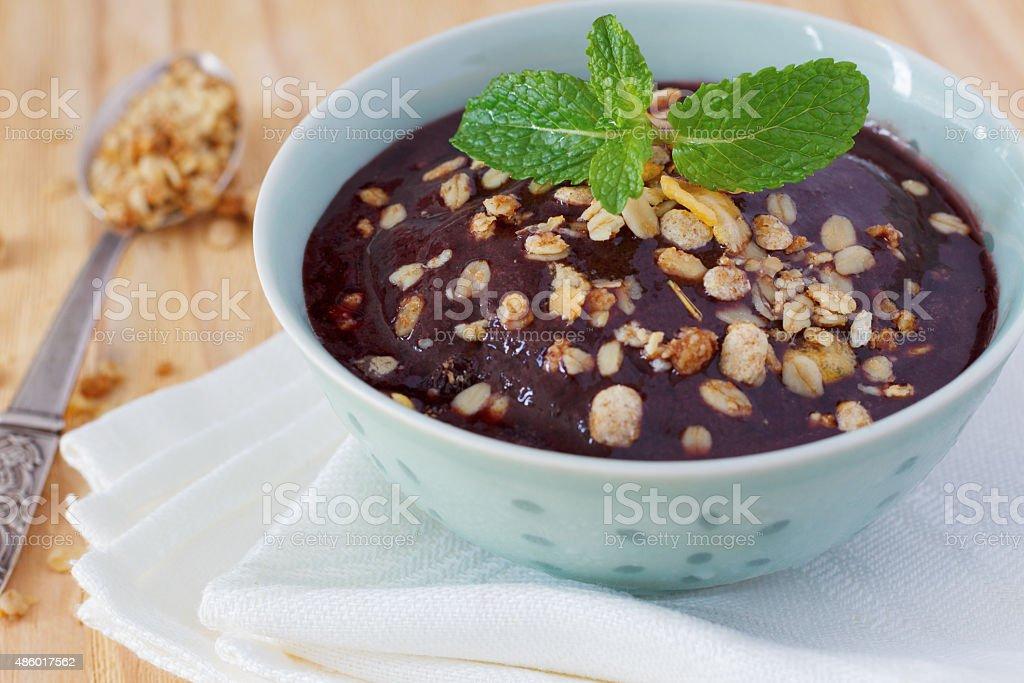 Brazilian dessert Acai pulp with muesli stock photo