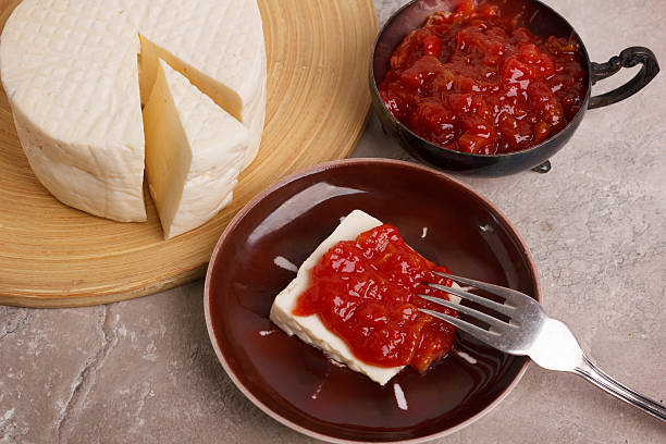 Brazilian dessert Romeo and Juliet, goiabada jam and cheese Minas Brazilian dessert Romeo and Juliet, goiabada jam of guava and cheese Minas on marble table. Selective focus guava stock pictures, royalty-free photos & images