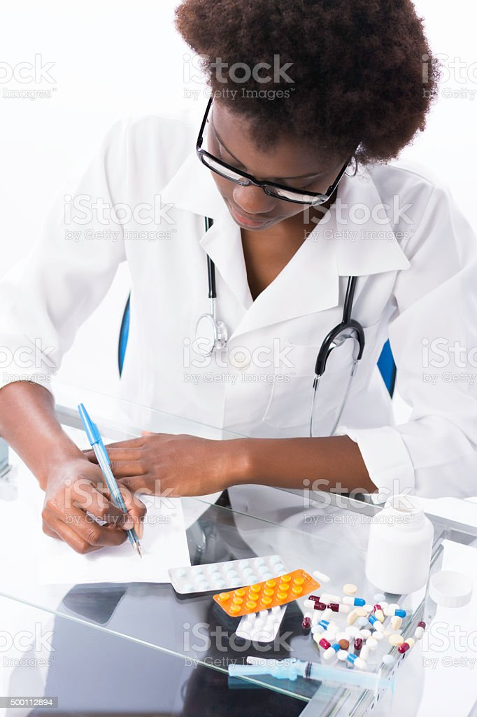 Brazilian doctor writting a presciption. stock photo