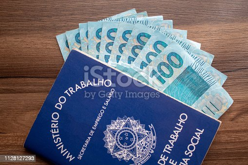Brazilian document work and social security ( Carteira de Trabalho e Previdencia Social) with brazilian money