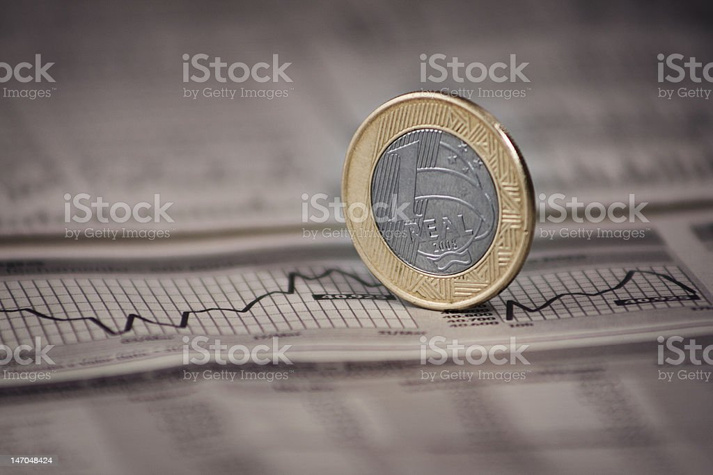Brazilian Economy Newspaper and Local Currency with Closeup stock photo