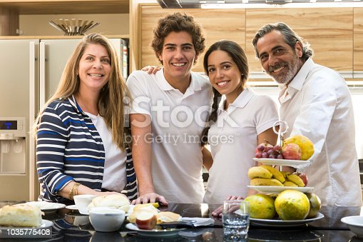 Brazilian family having a traditional breakfast. Concept of a family preparing for the day of work and school.