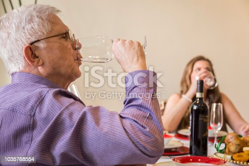 1035768506 istock photo Brazilian family sitting at dinner table celebrating Christmas together 1035768554