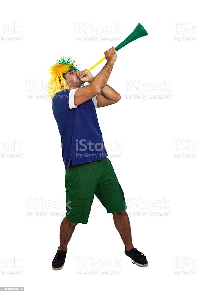 Brazilian fan blowing a stadium horn stock photo