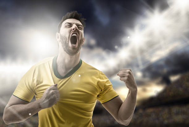 Brazilian fan celebrating in the stadium soccer collection american football league stock pictures, royalty-free photos & images