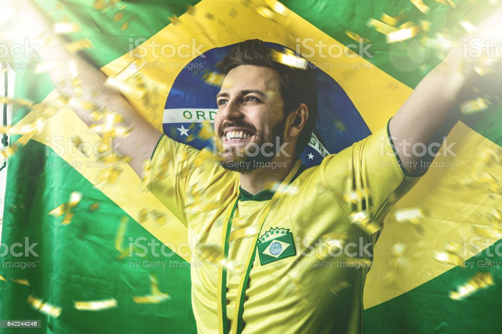 Brazilian fan celebrating stock photo