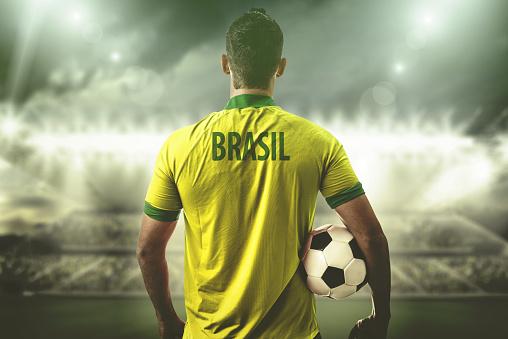 Brazilian Fan / Sport Player on uniform celebrating