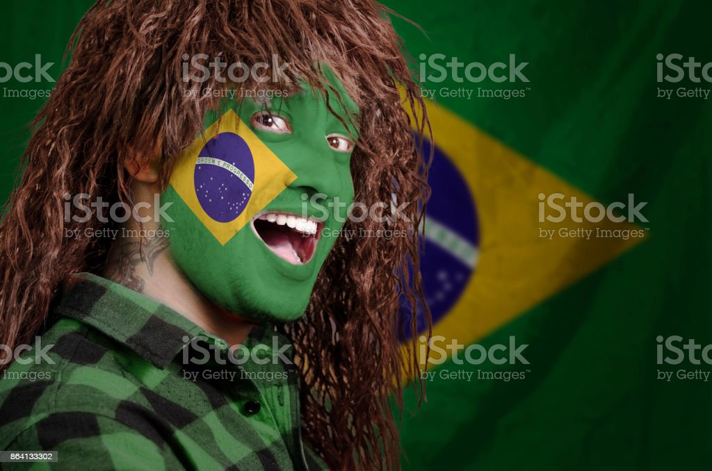 Brazilian fan with face painted royalty-free stock photo