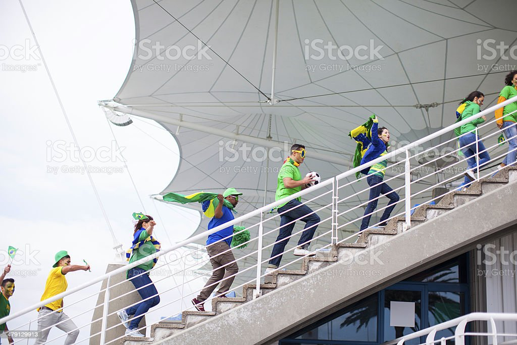 Brazilian fans walking up the stairs. stock photo
