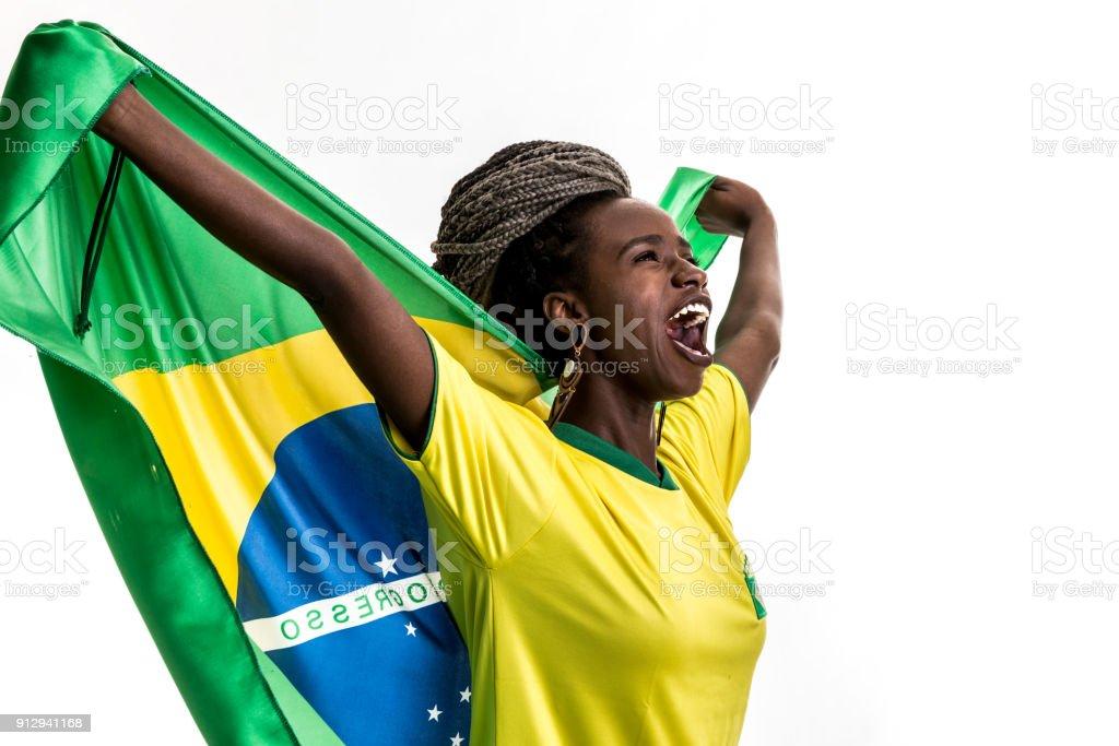 Atleta feminina brasileira / ventilador comemorando em fundo branco - foto de acervo