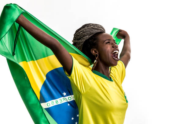Brazilian female athlete / fan celebrating on white background stock photo