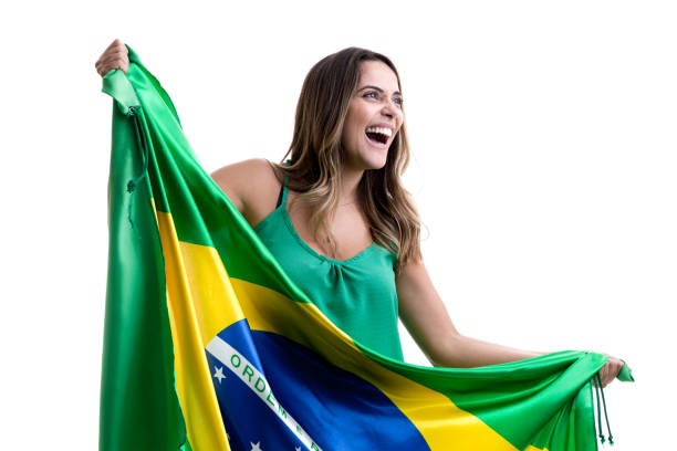 brazilian female fan celebrating on white background - soccer league stock pictures, royalty-free photos & images